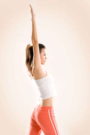 woman doing yoga by stretching hand straight