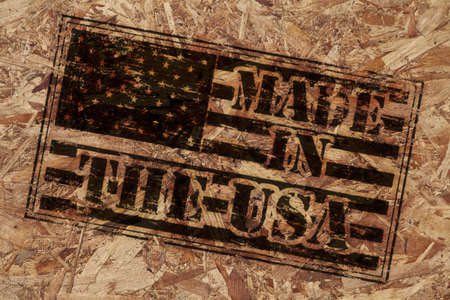 Made in the USA stamp on rough wooden background