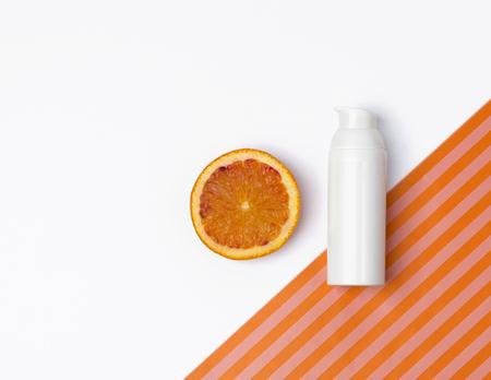 Natural Vitamin C Skincare Product With Orange Fruit Slices