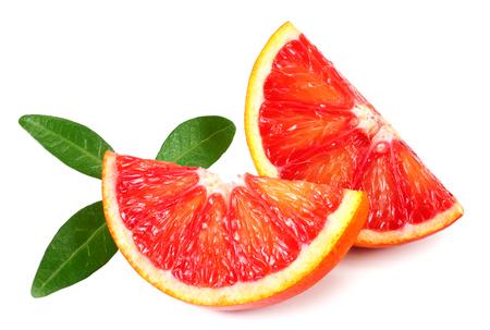 Foto de Slice of red blood orange with leaf isolated on white background - Imagen libre de derechos
