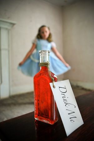Alice staring at a bottle of potion from a distance/Alice in Wonderland