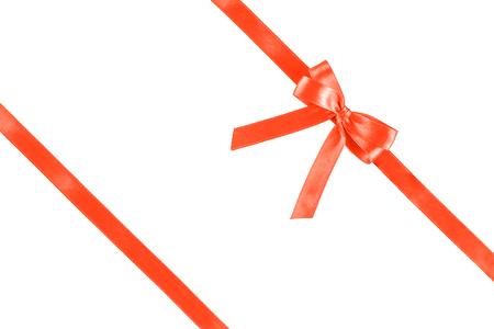 Foto de Shiny coral silk ribbon isolated on white background. Festive concept. Flat lay. - Imagen libre de derechos