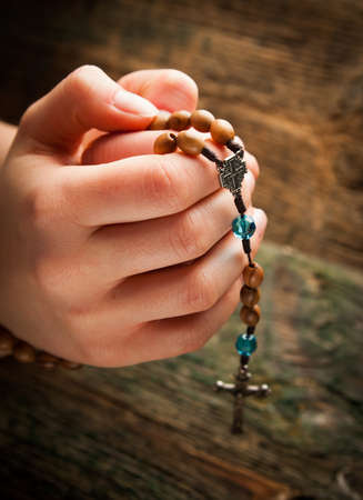 Young hands with rosary