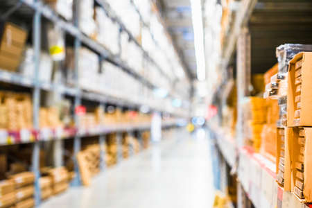 Photo for Rows of shelves with goods boxes in modern industry warehouse store at factory warehouse storage, Shelves and racks in distribution storage warehouse interior. interior of warehouse, Rows of shelves with boxes. - Royalty Free Image