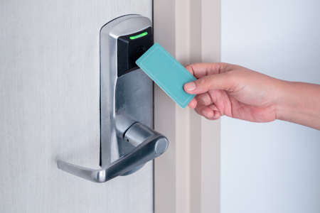 Photo for Hand using electronic smart contactless key card for unlock door in hotel or house. - Royalty Free Image