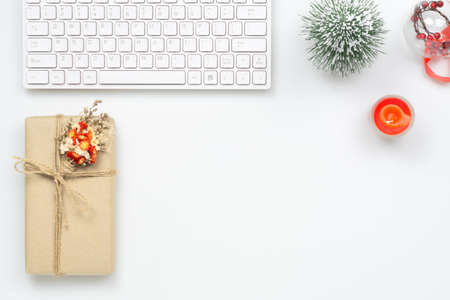 Foto de Merry Christmas and Happy new years office work space desktop concept. Flat lay top view with keyboard, natural gift box and Christmas ornaments with copy space. - Imagen libre de derechos