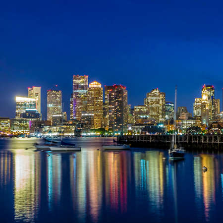 Photo for Boston downtown skyline panorama with skyscrapers over water at twilight - Royalty Free Image