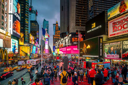 Foto per NEW YORK CITY - March 9: Times Square area with neon art and commerce, an iconic street of Manhattan on March 3, 2018 in New York City , United States  - Immagine Royalty Free