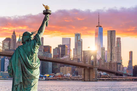 Statue Liberty and  New York city skyline at sunset,  in United States