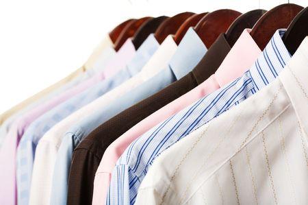 Foto de Close-up rack shirts isolated on white background - Imagen libre de derechos