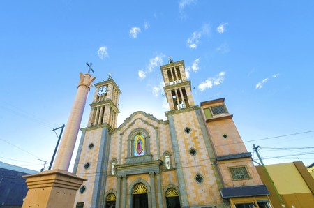 The Catedral de Nuestra Senora de Guadalupe, the first catholic church in Tijuana, Mexico of the Lady of Guadalupe. A view of the exterior of the cathedral, the arch, two towers, columns, clock and cross.