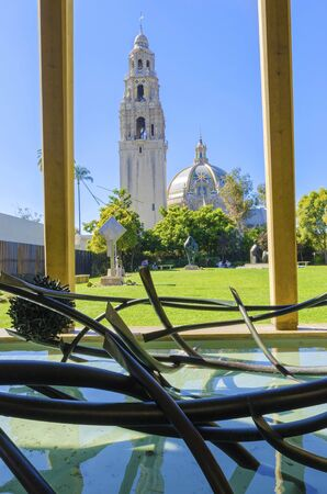 The mafnificent California bell tower and dome at the entrance of Balboa park in San Diego, United States of America. A colorful tile dome and tower of plateresque, baroque, Churrigueresque, rococo american architecture.