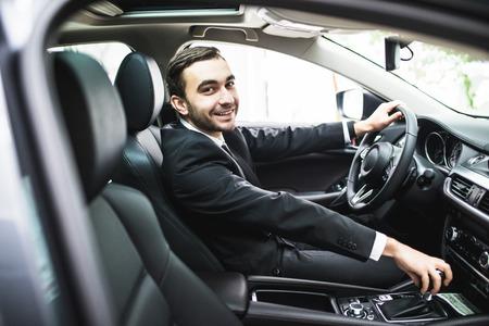 Foto de transport, business trip, destination and people concept - close up of young man in suit driving car - Imagen libre de derechos