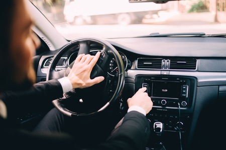 Photo pour Car dashboard. Radio closeup. Man sets radio - image libre de droit