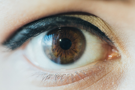 Photo for Close up picture of brown eyes from a young man - Royalty Free Image