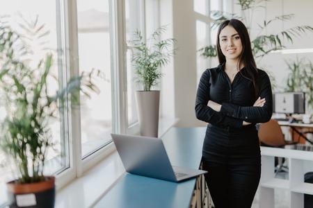 Photo pour Portrait of successful businesswoman standing at her office. - image libre de droit