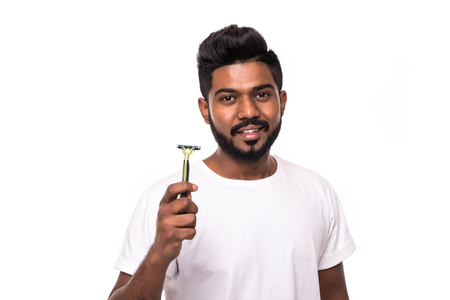 Photo pour Handsome young man standing with razor in hand on white background. Men care concept. - image libre de droit