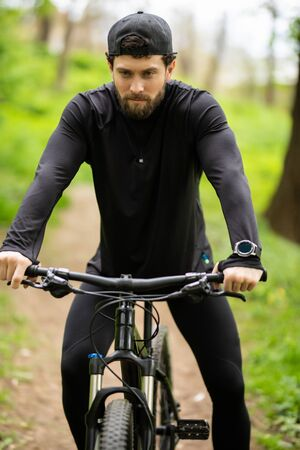 Photo for Happy Young man is riding bicycle outside. - Royalty Free Image