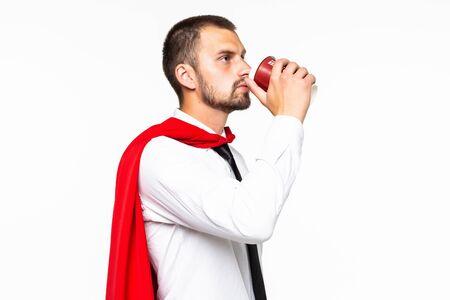 Photo for Businessman dressed like superhero drinking coffee - Royalty Free Image
