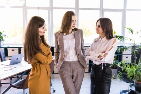Photo pour fine portrait of three young business women. concept about teamwork, business and finance - image libre de droit