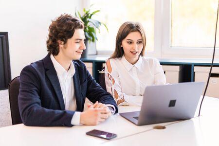 Photo pour Couple discussing new project on the laptop. Teamwork concepts. - image libre de droit