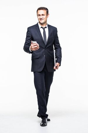 Photo pour full length of Successful businessman holding smart phone isolated on white - image libre de droit