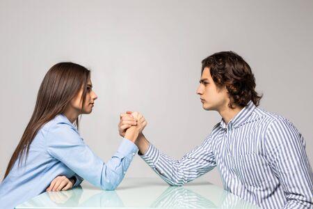 Photo pour Beautiful couple doing arm wrestling challenge - image libre de droit