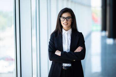 Photo pour Businesswoman crossed hands portrait in office with panormic windows. - image libre de droit