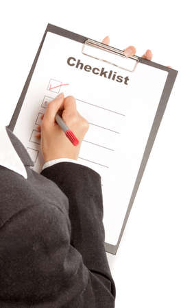 Woman with checklist and pencil