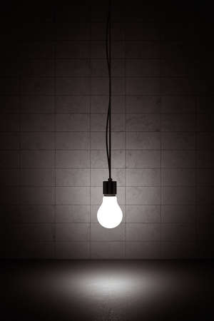 Light bulb hanging on a wire with concrete background