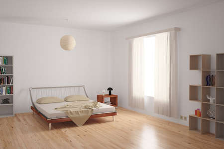 Modern bedroom interior with minimalistic furnishing in neutral colours on an uncarpeted hardwood floor.