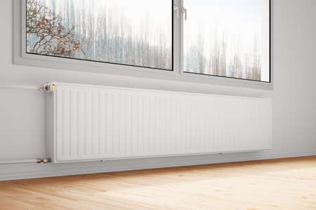 Central heating attachted to wall with closed windows