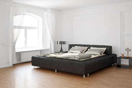 Sleeping room with bed and hardwood floor