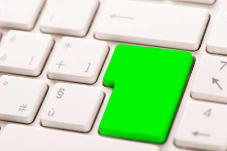 Foto per Green button on a white keyboard - Immagine Royalty Free
