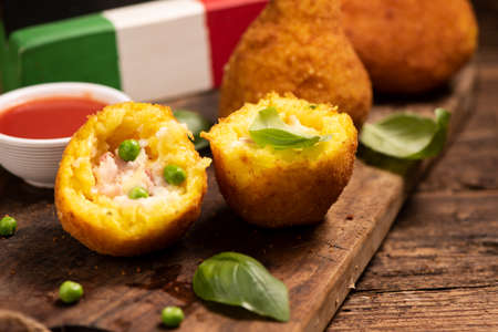 Photo for Delicious rice balls made with fried rice. typical dish of sicilian italian cuisine . Arancini close up - Royalty Free Image