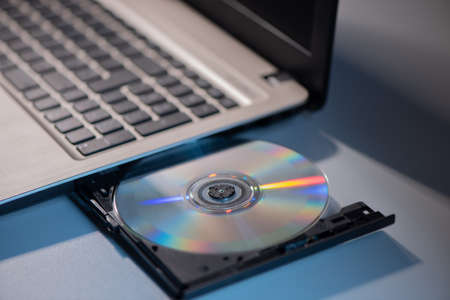 A laptop with compact disc close up shoot