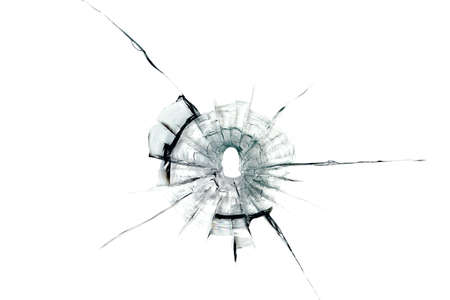 bullet hole in glass on white