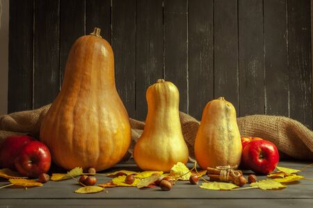 pumpkins on wooden board