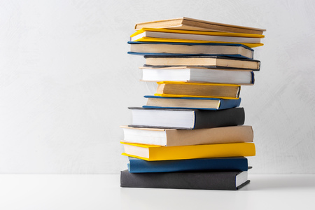 Photo pour pile of paperback books on a table - image libre de droit