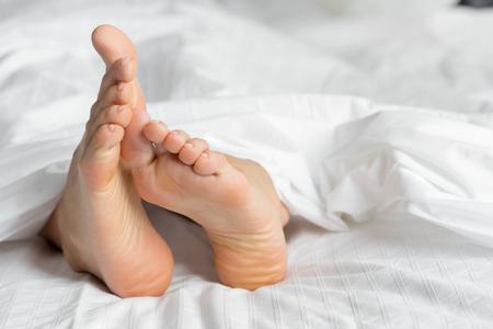 Foto de perfect and beautiful woman legs on bed - Imagen libre de derechos
