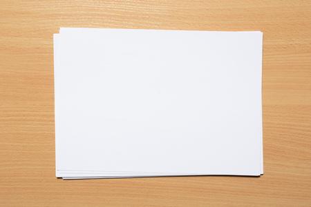 Photo pour White business card on wooden table. Blank portrait A4. - image libre de droit