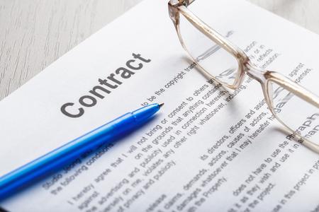 Photo pour Close up shot of Eyeglasses  on contract document papers business concept - image libre de droit