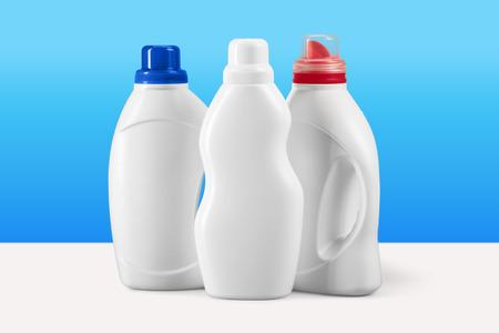 Photo pour Plastic liquid detergent containers on blue background - image libre de droit