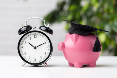 Photo for Piggy Bank With Graduation Cap - Royalty Free Image