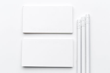Photo for White blank business card. Office table desk with pencil. Top view and copy space for ad text. creative photo. - Royalty Free Image