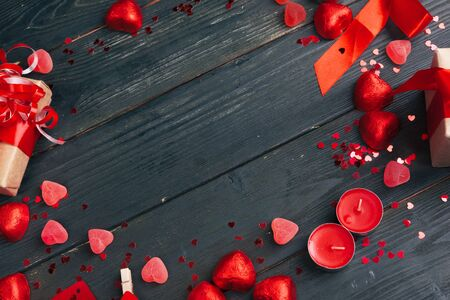 Photo for Gift box with red hearts on wooden table. creative photo. - Royalty Free Image