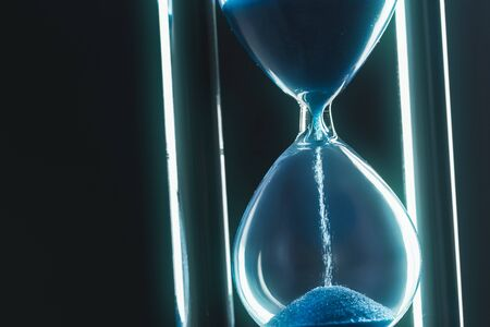 Photo pour Hourglass on dark background. Close up. - image libre de droit