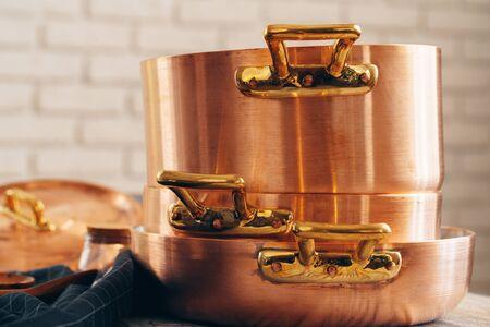 Foto de New copper cookware for professional kitchen close up - Imagen libre de derechos