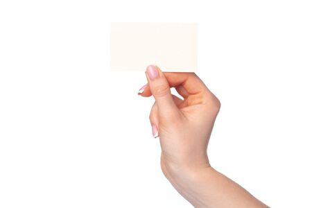 Photo pour Beautiful female hand holding white business card on white background - image libre de droit