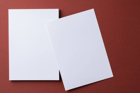 Photo for Blank white business cards on burgundy paper background, top view - Royalty Free Image
